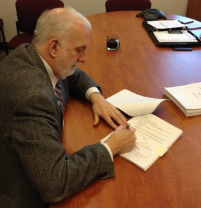 SBCTC Executive Director Marty Brown signs Ciber contract.
