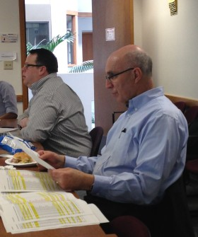 Andy and Dick discuss project activities and resources during the bi-weekly FirstLink planning meeting.
